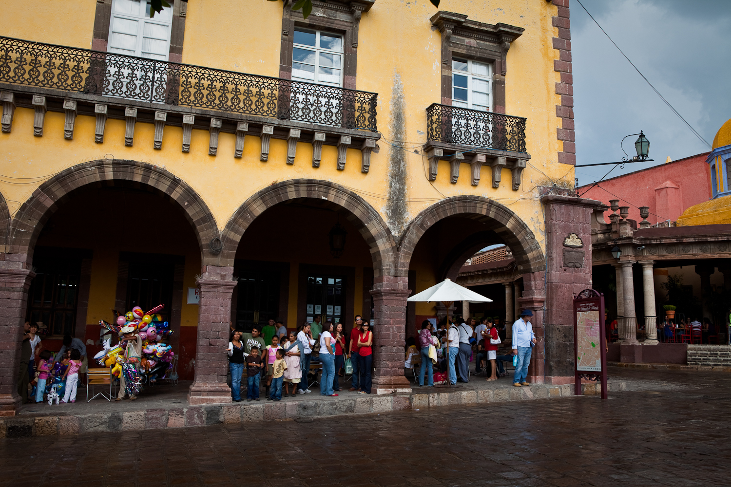 People hiding from the summer rain in downtown san miguel de allende, mexico