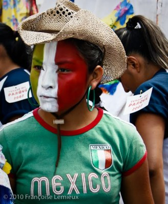 Young Mexican woman sports the colors of her flag.